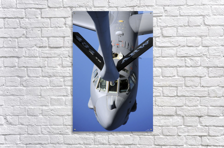 A B-52 Stratofortress moves into position to receive fuel.  Acrylic Print