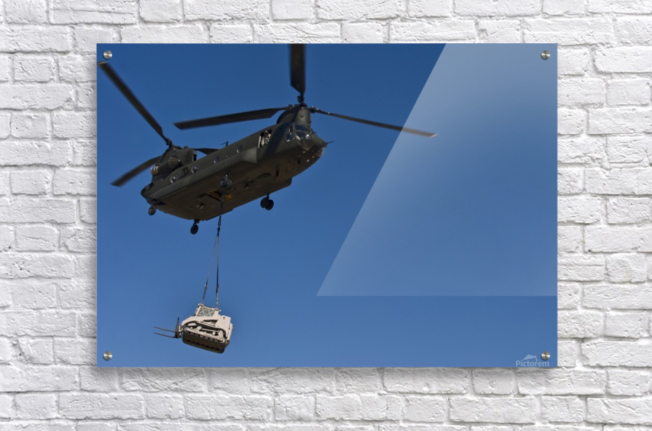A U.S. Army CH-47 Chinook carries a bulldozer to a drop site.  Acrylic Print
