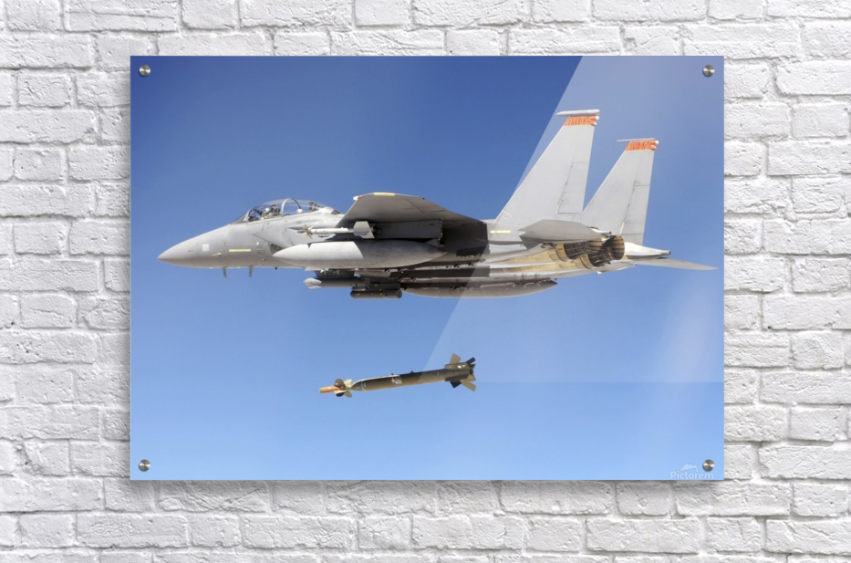 An F-15E Strike Eagle drops a GBU-28 bomb during a Combat Hammer mission.  Acrylic Print