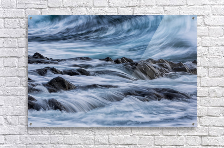Long exposure of waves striking the coastline and flowing over rocks; Iceland  Acrylic Print