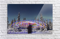 The Aurora Borealis dances over the top of a vibrant spiral light painting, the blurry figure of a man in the middle of the light painting, moonlight casting shadows on snow covered spruce trees on a clear winter night, interior Alaska; Gakona, Alaska, Un  Acrylic Print