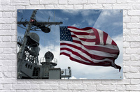 USS Cowpens flies a large American flag during a live fire weapons shoot.  Acrylic Print