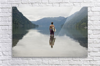A Young Man Wearing A Swimsuit Stands In Cameron Lake; British Columbia Canada  Acrylic Print