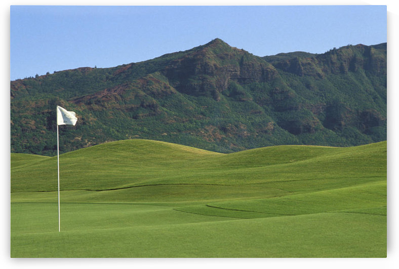 Hawaii, Kauai, Kauai Marriott Golf Course Rolling Hills With Mountains In Background, White Flag by PacificStock
