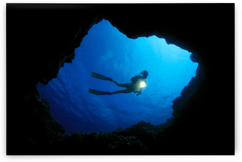 Hawaii, Big Island, Kona, Diver At Cavern Entrance With Flash Light, Silhouette A81E by PacificStock