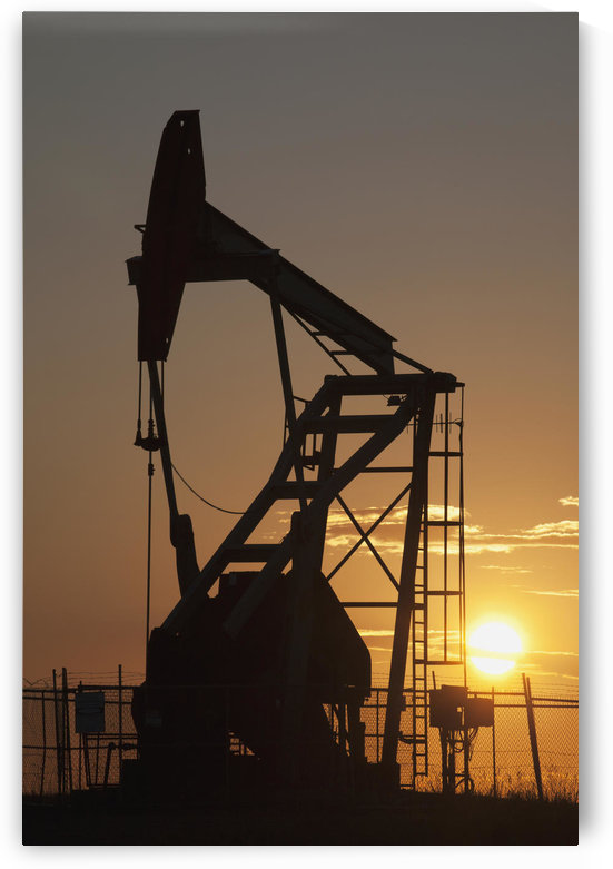Silhouette Of Pumpjack With The Orange Glow Of The Sun Rising; Longview,Alberta, Canada by PacificStock
