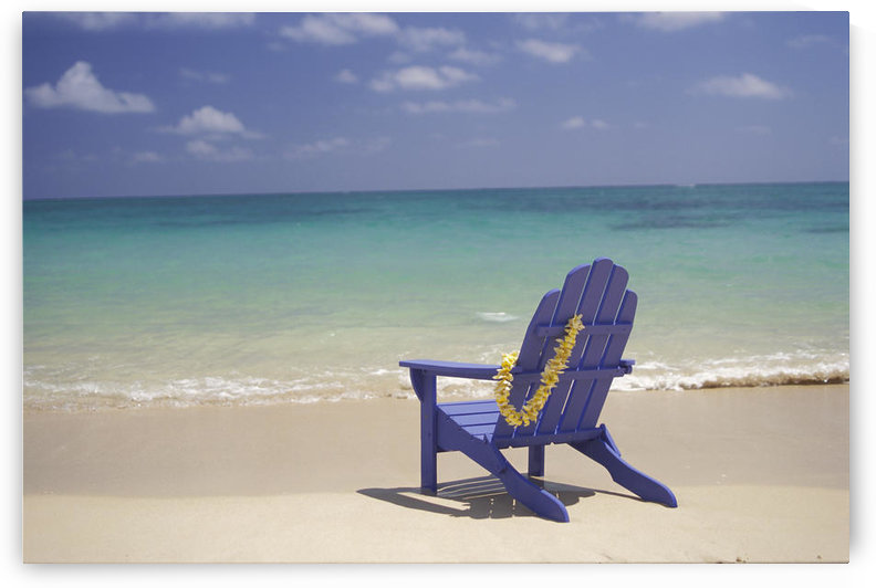 Plumeria Lei Hanging Over Blue Beach Chair Along Shoreline by PacificStock
