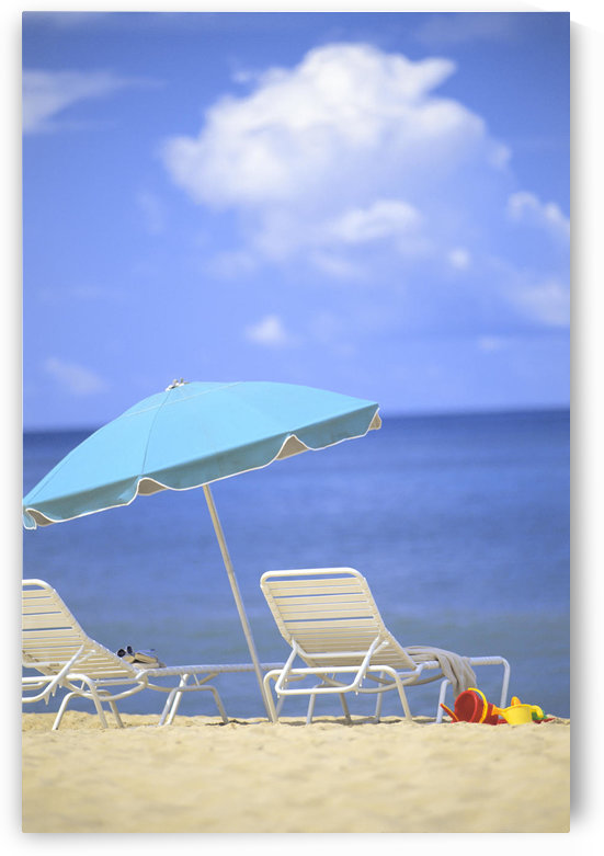Pair Of Beach Chairs And An Umbrella On White Sand Beach With Blue Skies And Water by PacificStock