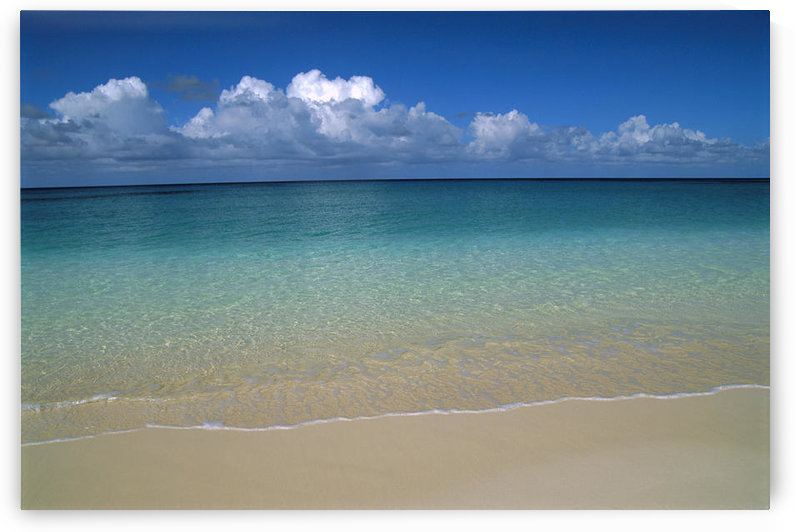 Calm Shoreline Water With Many Different Shades Of Blue, Clouds Above Horizon by PacificStock