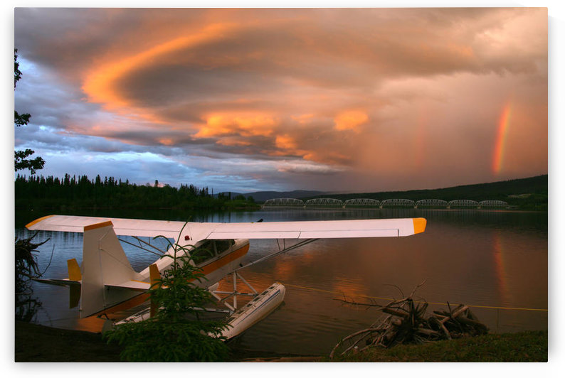 Sunlit Storm Clouds Over A Float Plane With Rainbow And Teslin Bridge In Background, Teslin Lake, Yukon by PacificStock
