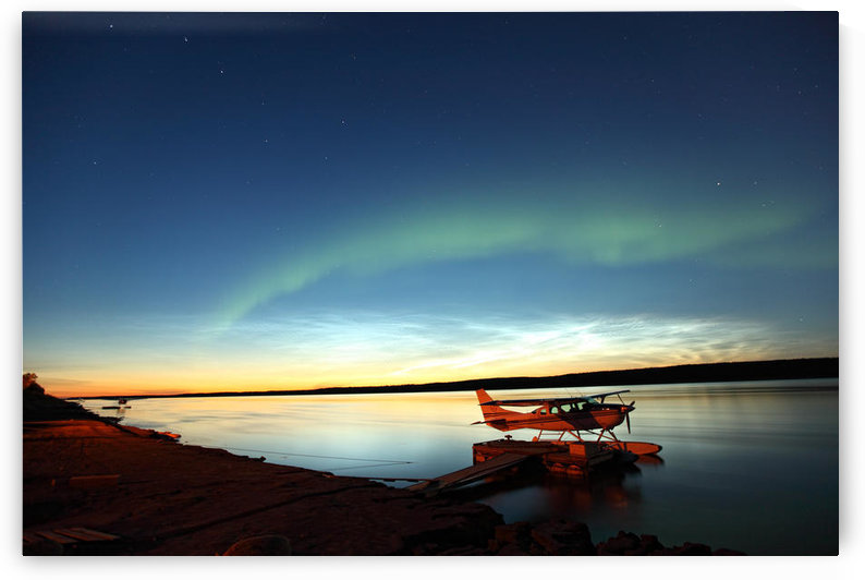 Aurora Borealis Over The Mackenzie River With Float Planes In Foreground, Fort Simpson, Northwest Territories by PacificStock