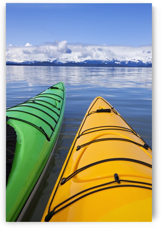 Kayakers enjoy a tranquil morning paddle in Lynn Canal, Alaska, near Juneau. Chilkat Mountains beyond. by PacificStock