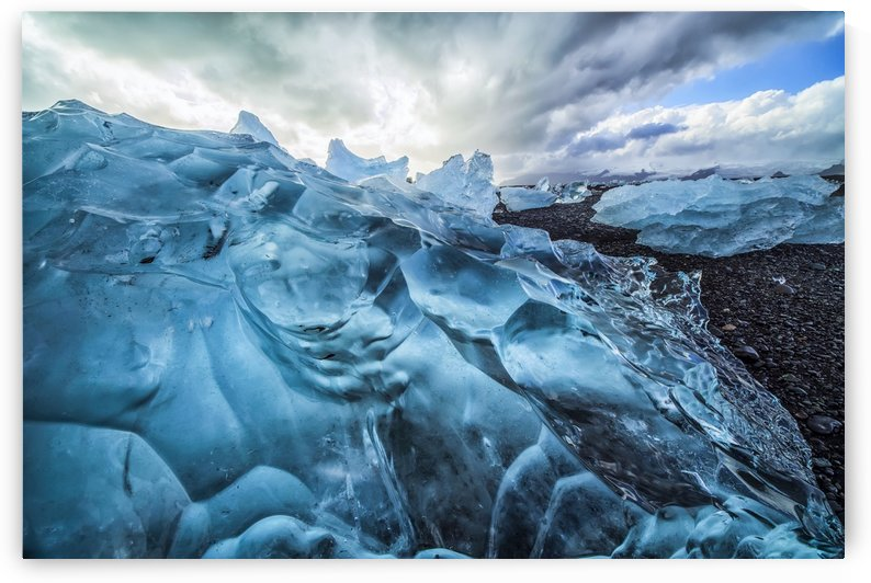 Along the south shore of Iceland, large chunks of ice litter the beach after being washed out to sea from the Jokulsarlon lagoon; Iceland by PacificStock