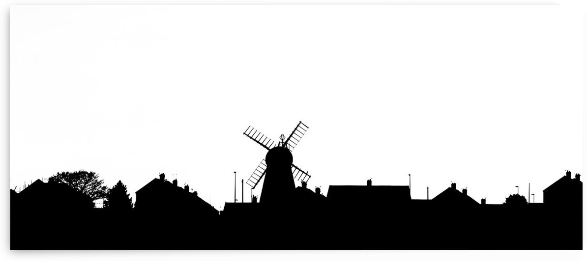 Silhouette of a skyline with a windmill and houses; Whitburn, Tyne and Wear, England by PacificStock