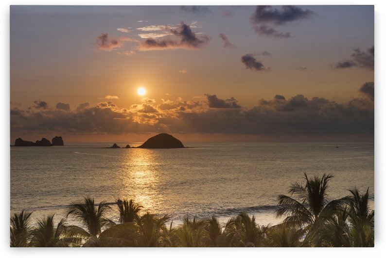 Sunset over the islands in front of Ixtapa; Ixtapa, Mexico by PacificStock