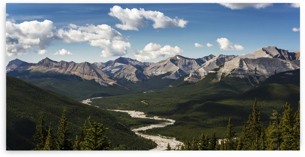 Panorama of river valley and mountain range with blue sky and clouds; Bragg Creek, Alberta, Canada by PacificStock
