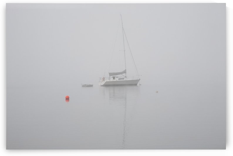 Sailboat moored in the fog; Magog, Quebec, Canada by PacificStock