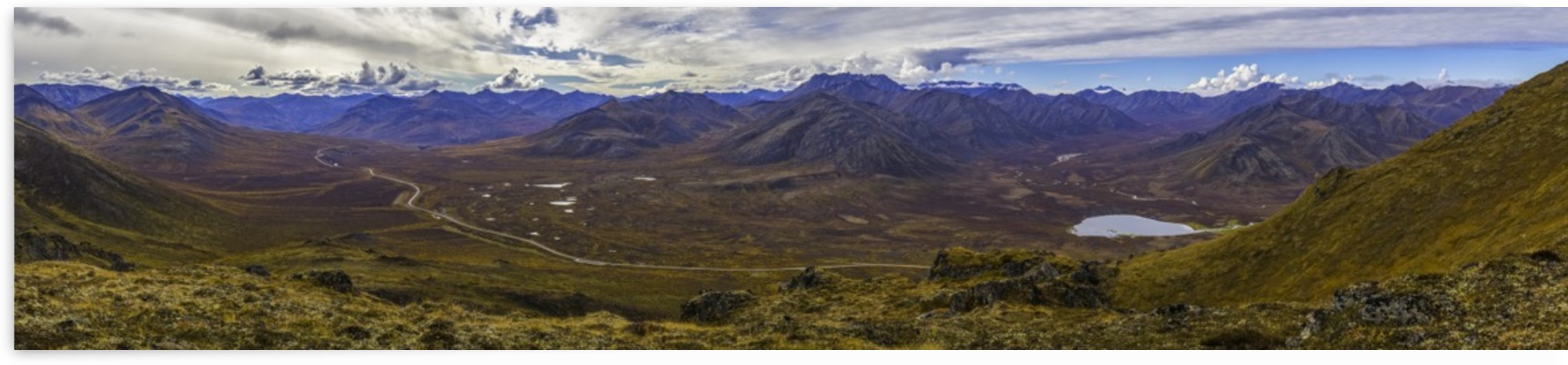 Panoramic image of the landscape in autumn colours along the Dempster Highway; Yukon, Canada by PacificStock