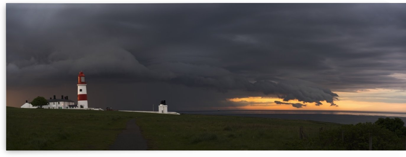 Souter Lighthouse under ominous storm clouds; South Shields, Tyne and Wear, England by PacificStock