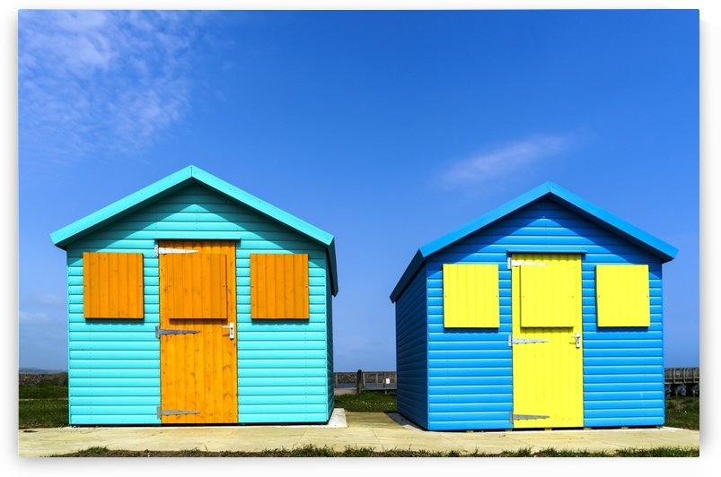 Two colourful buildings side by side with boarded up windows; Amble, Northumberland, England by PacificStock