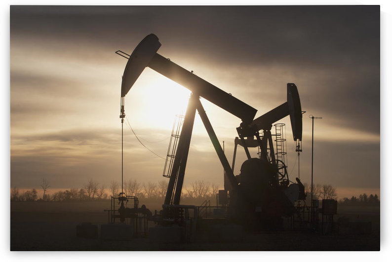 Silhouette Of Two Pump Jacks At Sunrise With Clouds; Alberta, Canada by PacificStock