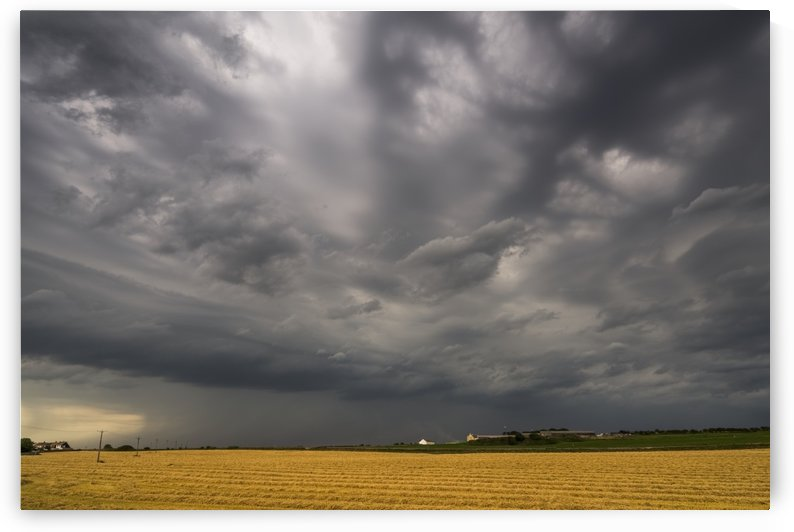 Dark storm clouds over a farm field; Whitburn, Tyne and Wear, England by PacificStock
