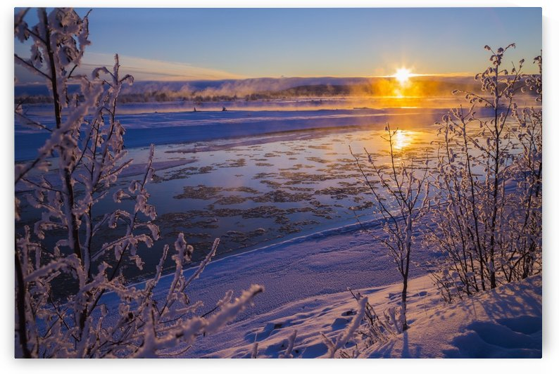 Ice flows in the Tanana River at sunset during freeze up in early winter; Alaska, United States of America by PacificStock