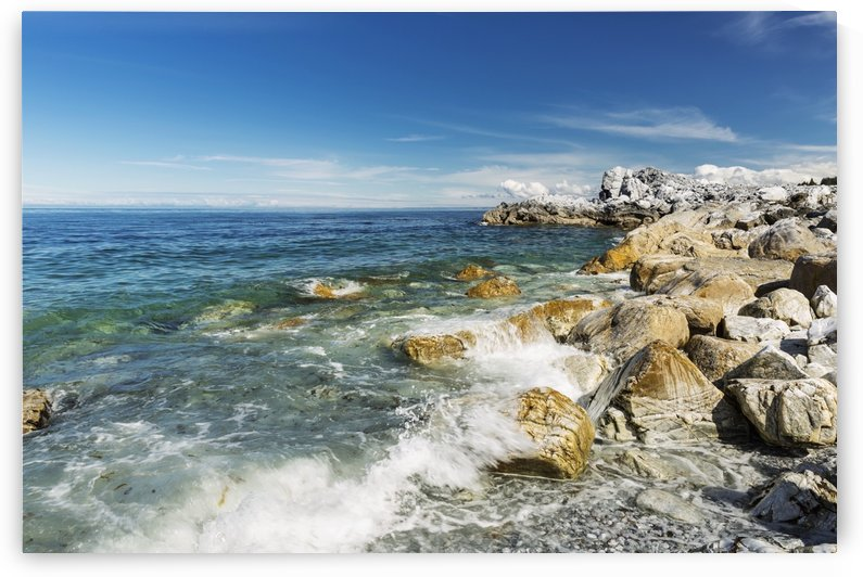 A wave crashes into Rocky Beach on a clear sunny day, Seldovia, Southcentral Alaska, USA, Summer by PacificStock