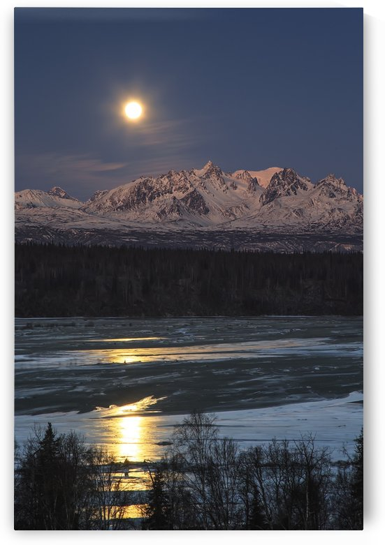 Super Moon as it descended over the Denali Range and Chulitna River, along the Parks Highway; Trapper Creek, Alaska, United States of America by PacificStock