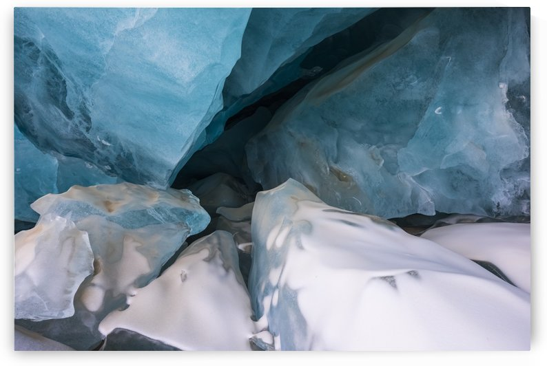 Pieces of collapsed ice inside a Black Rapids Glacier cave; Alaska, United States of America by PacificStock