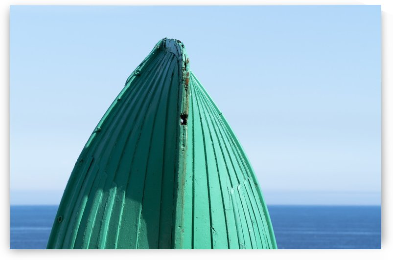 Close-up of  the bottom of the bow of a wooden boat painted green and the tranquil water and blue sky in the background; South Shields, Tyne and Wear, England by PacificStock
