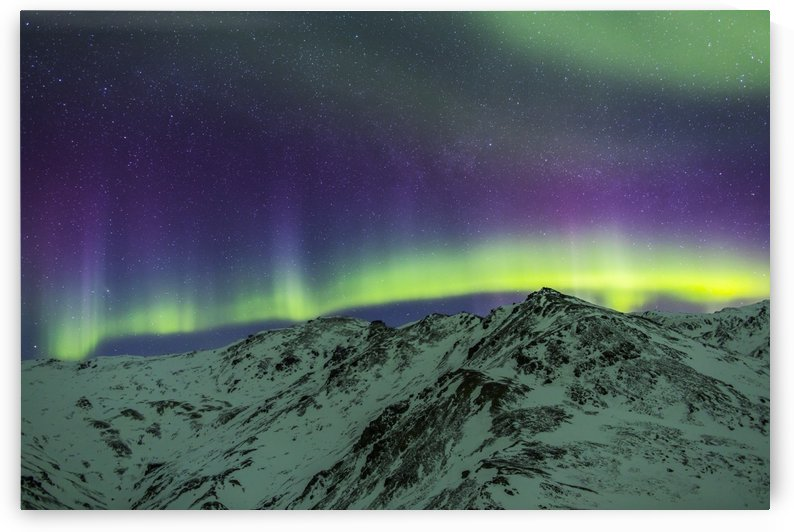 Aurora borealis over mountains within Denali National Park on a very cold winter night.  The Andromeda Galaxy is visible to the left; Alaska, United States of America by PacificStock