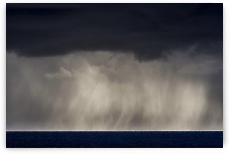 Rain falls over the ocean; Cannon Beach, Oregon, United States of America by PacificStock