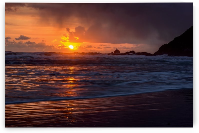 Rain falls on the waves during a sunset on the Oregon Coast; Cannon Beach, Oregon, United States of America by PacificStock