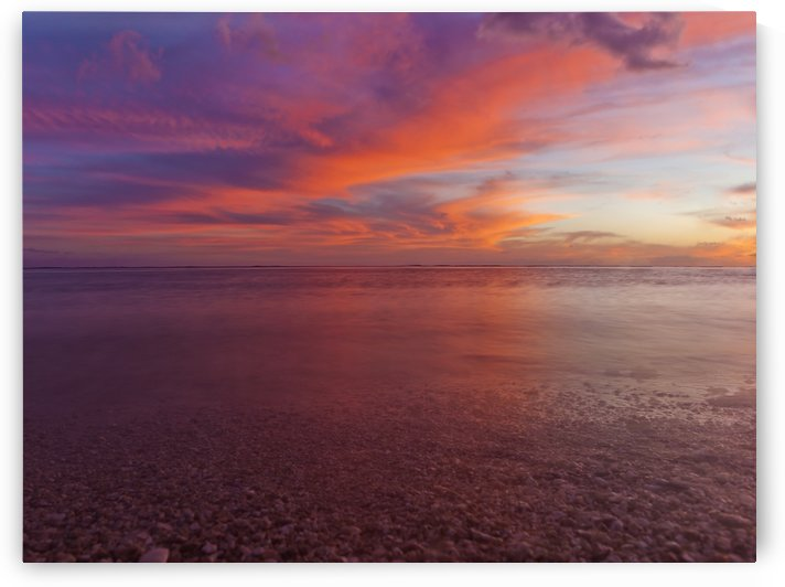 A dramatic beachscape with sunset colours of the sky and ocean taken in long exposure; Honolulu, Oahu, Hawaii, United States of America by PacificStock