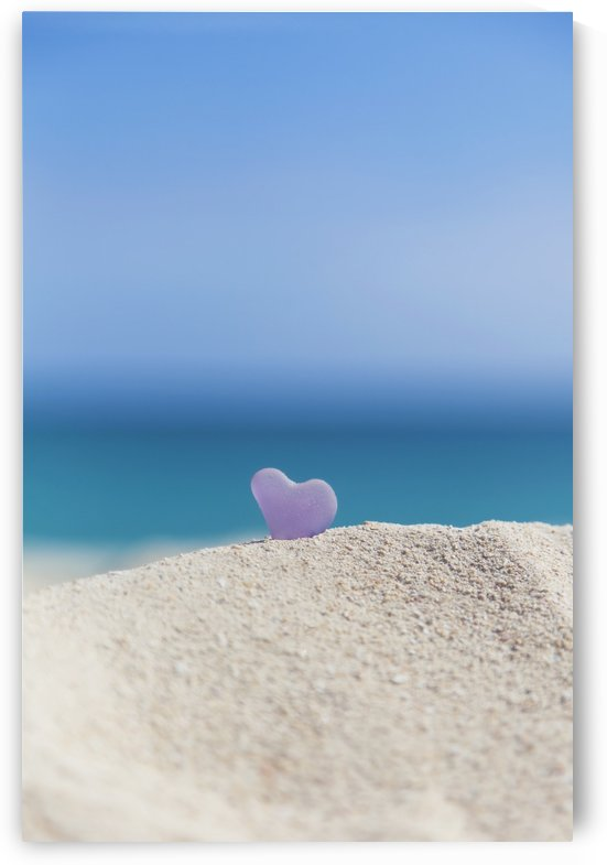 A lavender heart shaped sea glass in the sand at the beach; Honolulu, Oahu, Hawaii, United States of America by PacificStock