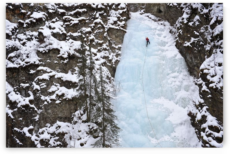 Woman Ice Climber Ascends A Large Icefall In Southcentral Alaska by PacificStock
