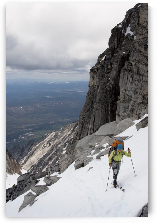 View Of Female Skier By Granite Cliffs Above The Swift River At The South End Of The Revelation Mountains, Summer In Southcentral Alaska by PacificStock