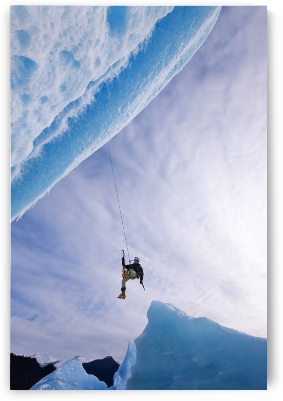An Ice Climber Swings Down From Rope To Reach Face Of A Large Iceberg Frozen Into Mendenhall Lake, Juneau, Southeast Alaska, Winter by PacificStock