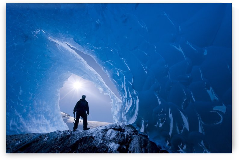 Composite: View From Inside An Ice Cave Of An Iceberg Frozen In Mendenhall Lake As An Ice Climber Stands At The Entrance, Juneau, Southeast Alaska, Winter by PacificStock
