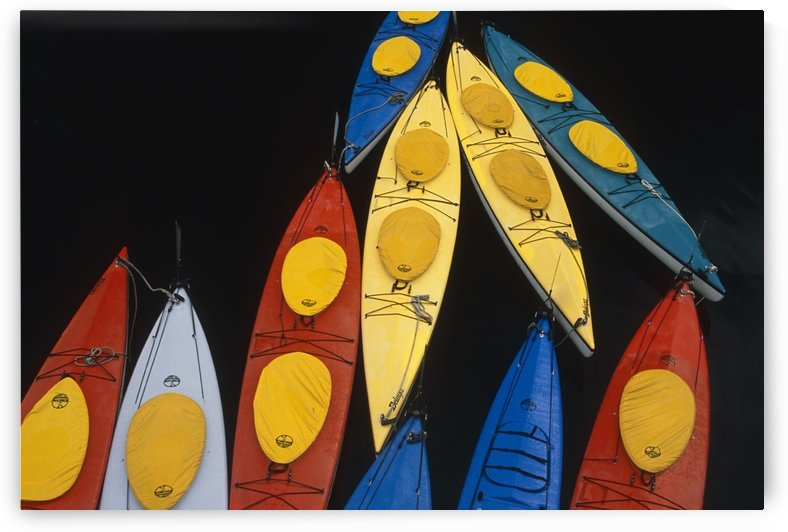 Abstract Overview Of Colorful Kayaks Tied Up Together On Water Inside Passage Southeast Alaska by PacificStock