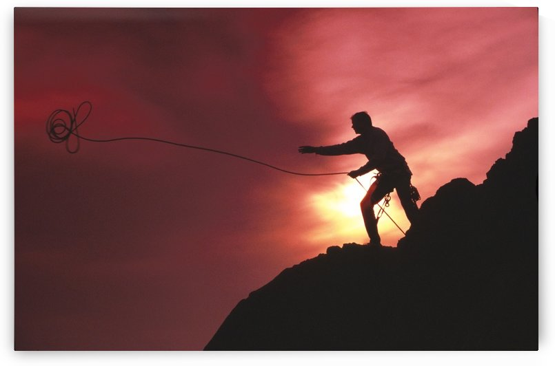 Man Mountain Climbing @ Sunset Chugach Mts Sc Ak/Nsilhouette Throwing Rope by PacificStock