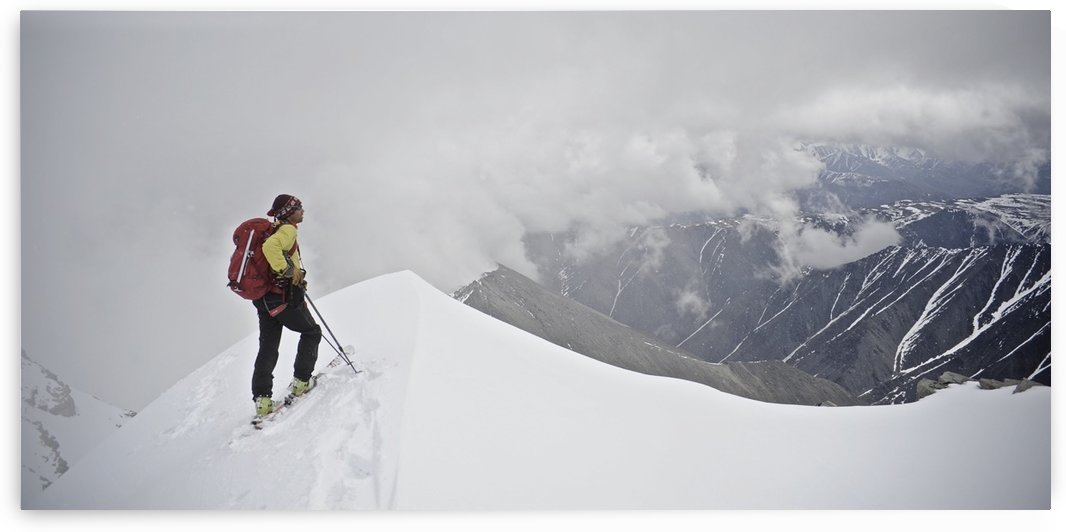 Man Skiing The North Ridge From The Summit Of Mt. Chamberlin In The Brooks Range, Arctic National Wildlife Refuge, Arctic Alaska, Summer by PacificStock