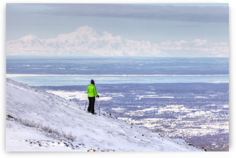 Woman snowshoer taking in the view of Mt. McKinley (Denali) from Blueberry Hill at the Glen Alps area of Chugach State Park, Anchorage, Southcentral Alaska, Winter, HDR by PacificStock