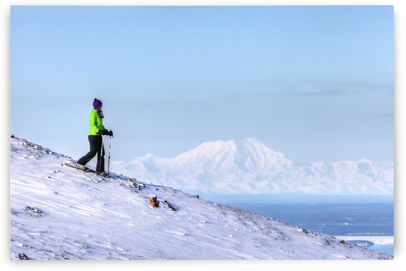Woman snowshoeing on Blueberry Hill at the Glen Alps area of Chugach State Park with Mt. Foraker in the background, Anchorage, Southcentral Alaska, Winter, HDR by PacificStock