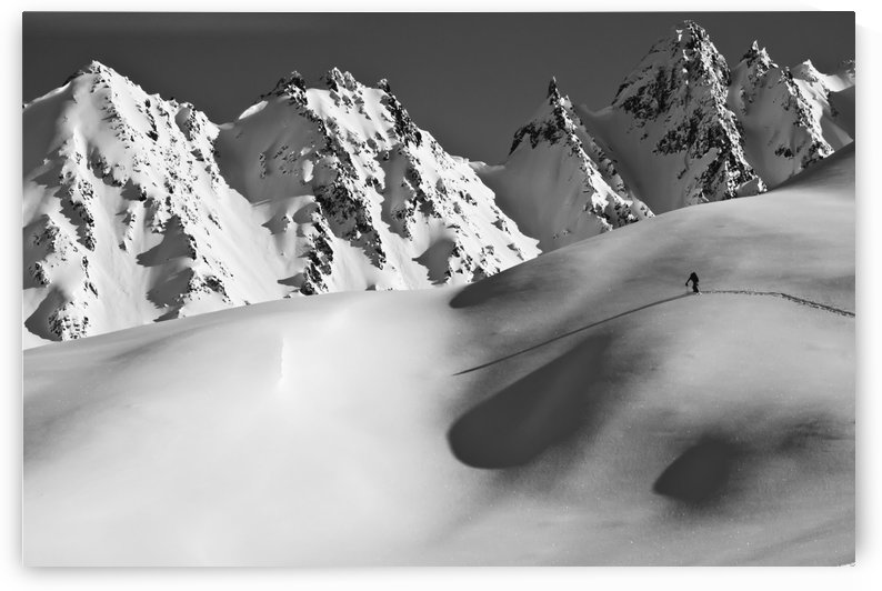 Backcountry skier skinning in the Iguana Backs of the Chugach Range above Valdez, Southcentral Alaska by PacificStock