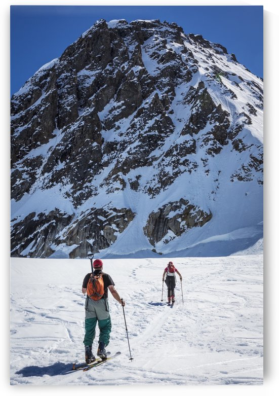 A couple telemark skiing on the Ruth Glacier near the Don Sheldon Hountain House in the Alaska Range, Interior Alaska, Summer. by PacificStock