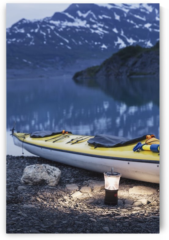 Kayak and lantern on the beach with mountains in the back ground at dusk, Shoup Bay State Marine Park, Prince William Sound, Valdez, Southcentral Alaska by PacificStock