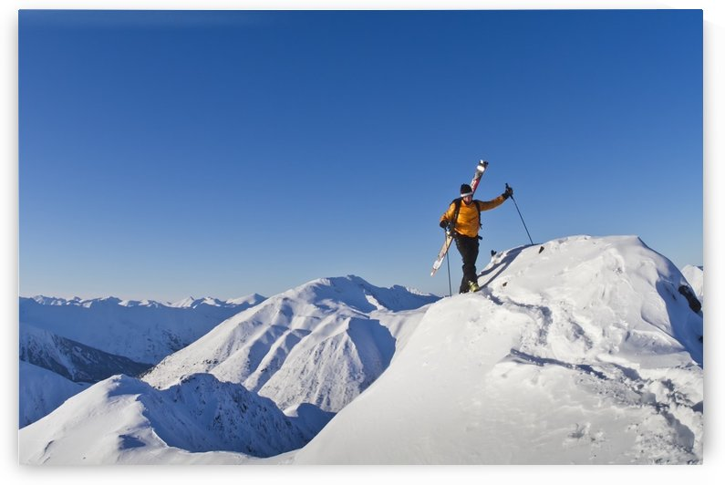 Man climbing a snow ridge for back country skiing, Turnagain Pass, Kenai Mountains, Southcentral Alaska, Winter by PacificStock
