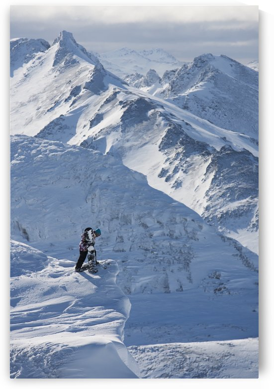 Professional snowboarder looking over the ledge at extreme terrain, Ushuaia, Patagonia, Argentina, South America by PacificStock